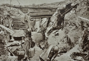 Scene from the Trenches, a soldier keeps watch while his exhausted colleagues sleep. Ovilliers