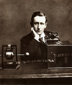Guglielmo Marconi publicity photograph in front of his early radio apparatus. Smithsonian Institute Libraries Wikimedia