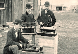 Post Office engineers inspecting Marconi apparatus for the Cardiff - Flat Holm experiment in May 1897. Wikimedia