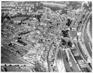 Aerial view of central Dover in the 1930s Pencester Gardens is easily identifiable as the open space in the top left quadrant with circular and cross footpaths the Stembrook area is on the sea side. Dover Museum