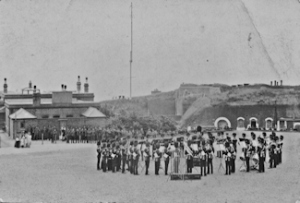 Guards band playing at Archcliffe Fort c1905. The wireless mast behind is the Spioen Kop Coastguard wireless station in the Citadel. Dover Museum