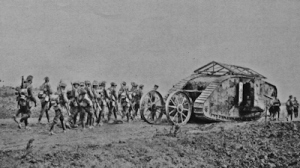 A Mark 1 tank first used at the Battle of Fleurs-Courcelette 15.09.1916 with infantry soldiers. Tom Robinson Collection
