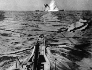 A torpedo hitting a merchant vessel showing the weapon's destructveness. I.W.M.