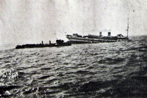 Anglia - sinking of hospital ship off Dover. The Ure rescuing ship in attendance. Dover Patrol