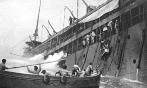 Crew of a doomed merchant vessel leaving their ship after being torpedoed by the Germans. Cossira