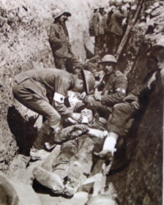 Non-combatant stretcher bearers in the trenches giving first aid at the Somme 1916. I.W.M